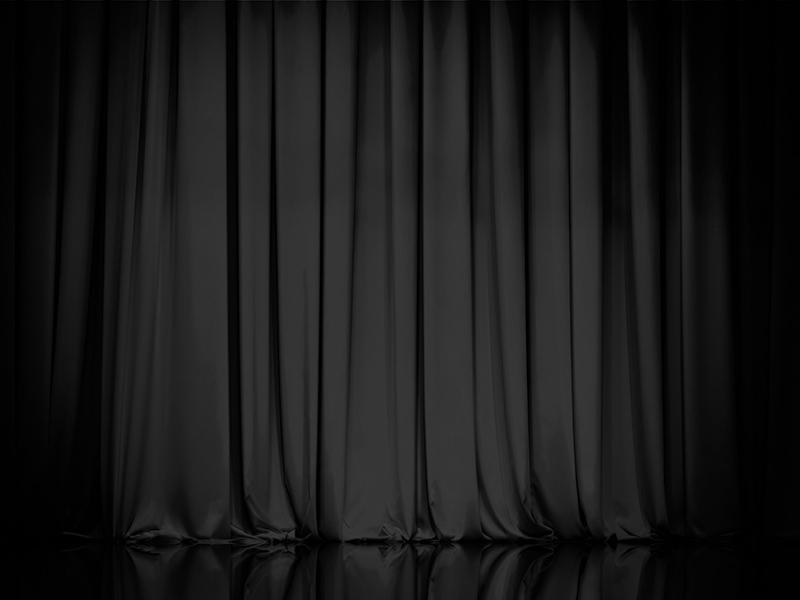 A black and white photo of a curtain