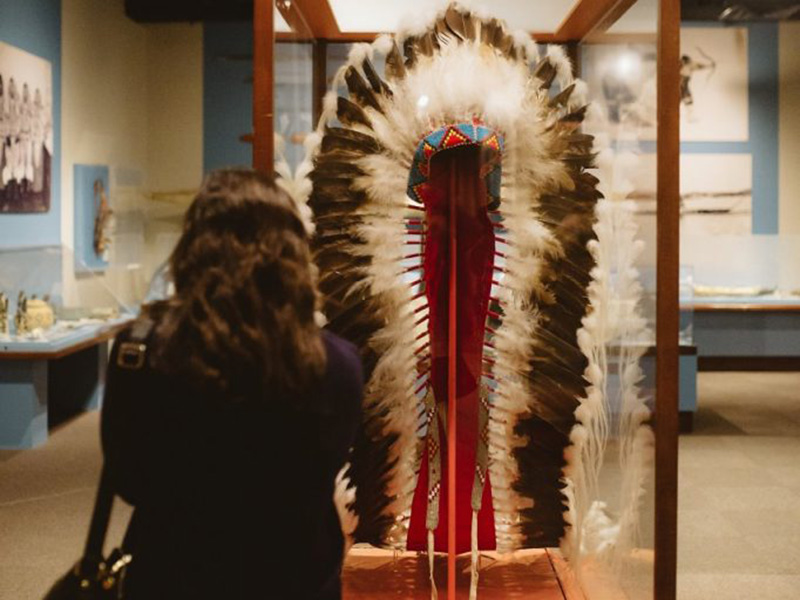 A person exploring New Sun Gallery of Indigenous Art and Culture at Glenbow