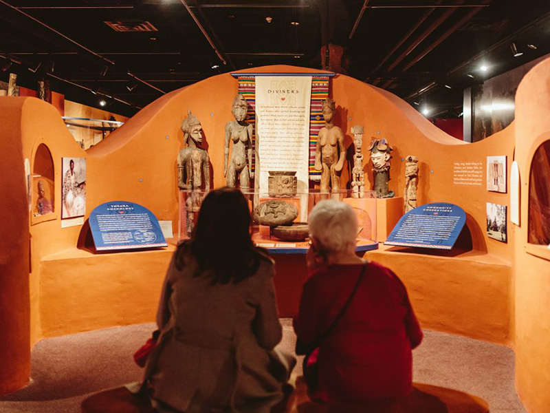 Two people in the Where Symbols Meet gallery at Glenbow