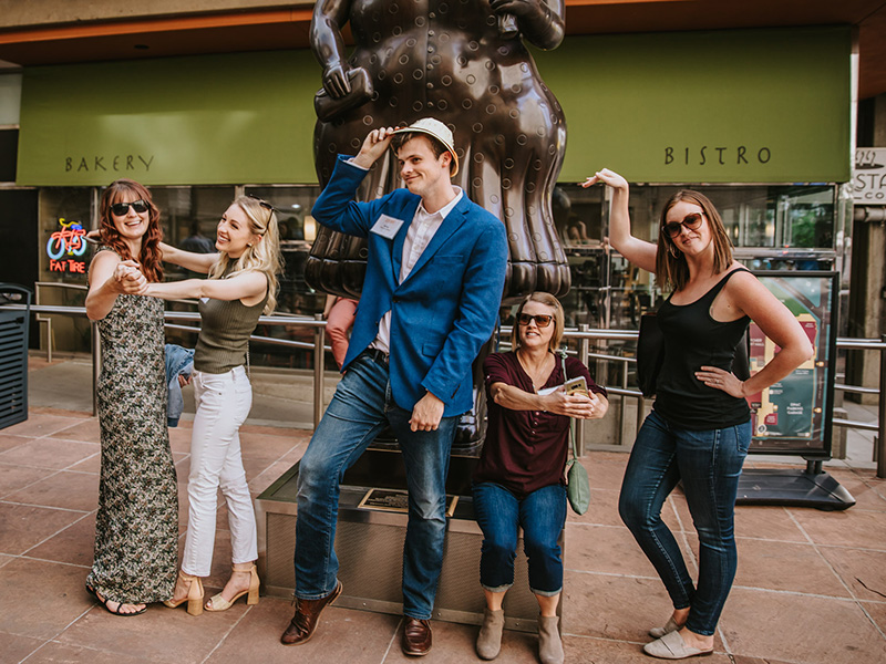 A photo of people on a Let's Roam scavenger hunt in downtown Calgary