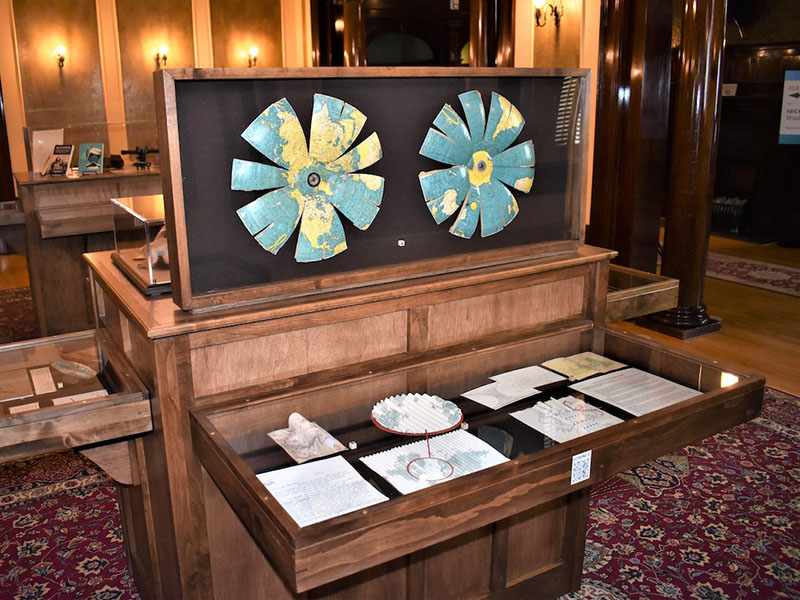 A photo of Beyond the Edge on display at the Lougheed House