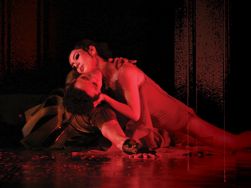Dancers embrace on stage in Beijing Dance Theater's dance and drama, adapted from Shakespeare's Hamlet