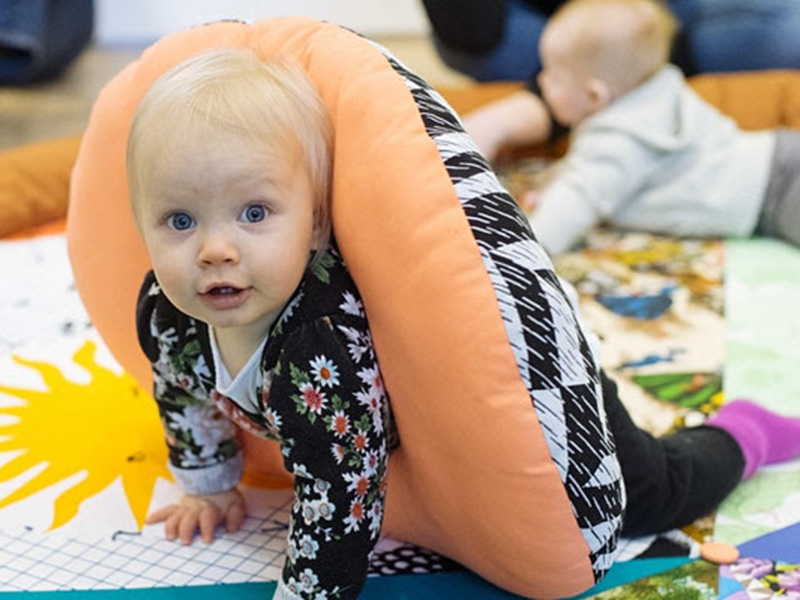 A photo of a baby at the Esker Foundation captured by Elyse Bouvier