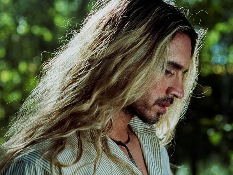 A dramatic photograph of a person with long hair