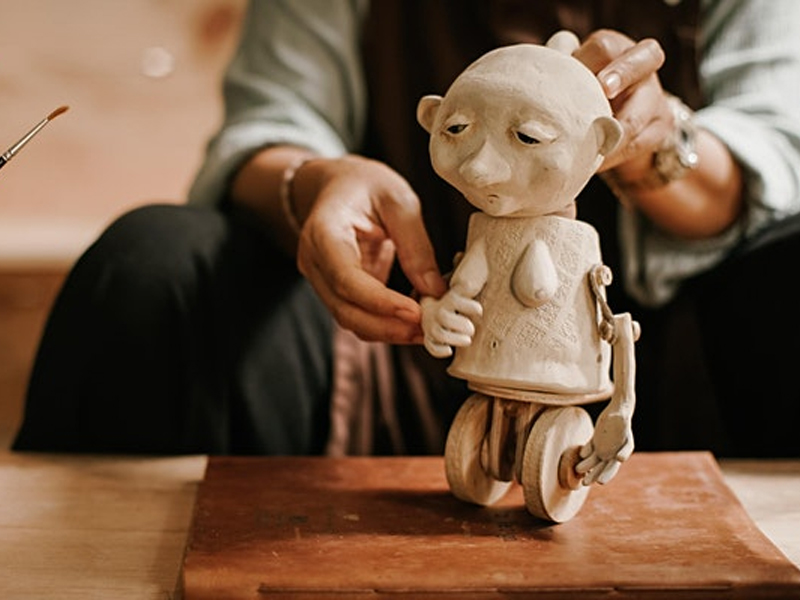 An image of a person holding a puppet